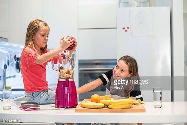Girls making fruit smoothie