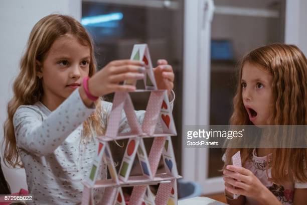 Girls making house of cards
