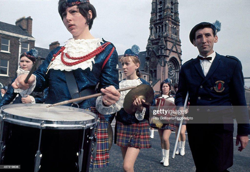 A girls marching band wearing tartan uniforms during an Orange Order march in Belfast, Northern Ireland, circa July 1971.