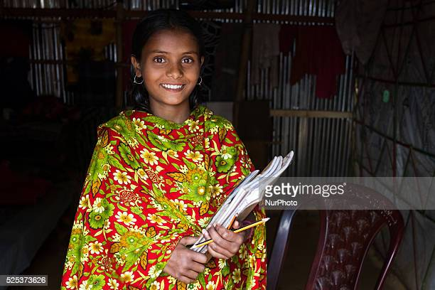A girls named Fulmala is going to school from her house inside stone workers' village on April 4 2015 in Jaflong Sylhet Bangladesh Stone workers live...