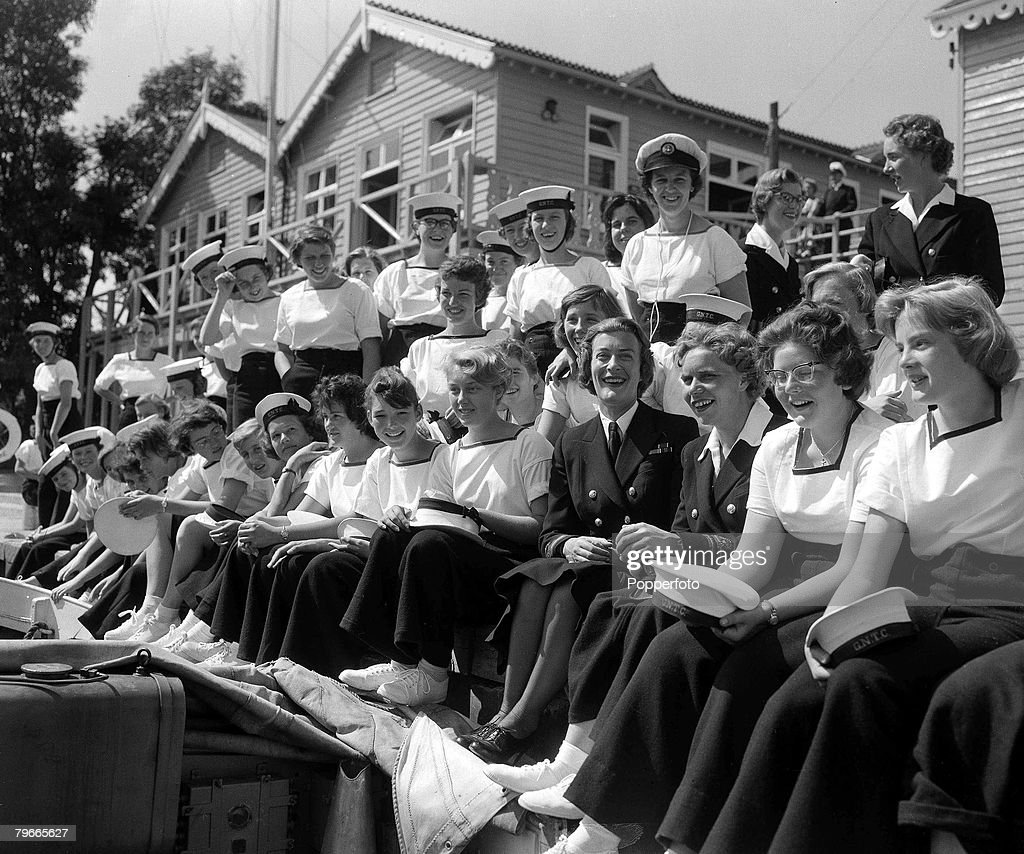 Girl's Nautical Training Corps Commandant Lady Mountbatten (bottom row, 4th right) at Surbiton, Surrey training course, 18th August 1959 : News Photo