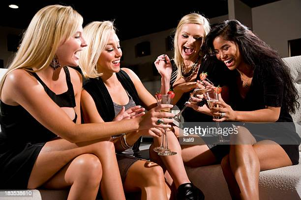 Girls night out - group of women celebrating with champagne