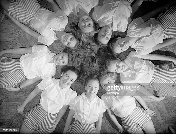 Girls of Aida Foster stage school in North London lie down next to each other forming a circle on the floor 18th November 1952