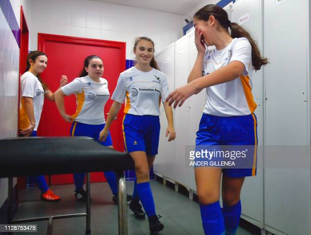 Girls of Anorga KKE football school leave the locker room to attend a training session in the Spanish Basque city of San Sebastian on February 23 2019