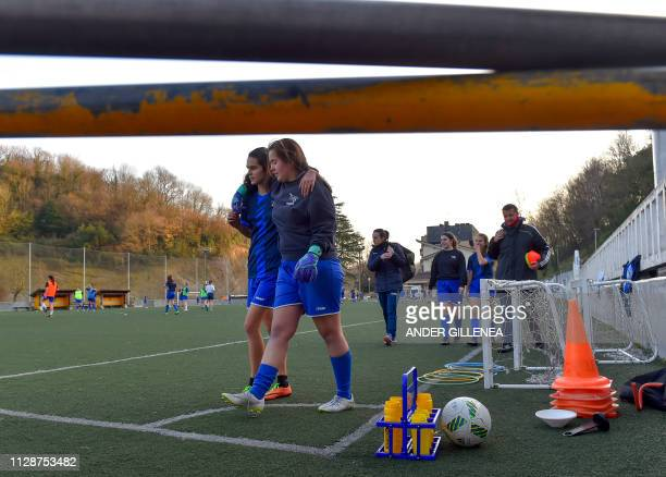 Girls of Anorga KKE football school leave the pitch after attending training session in the Spanish Basque city of San Sebastian on February 20 2019