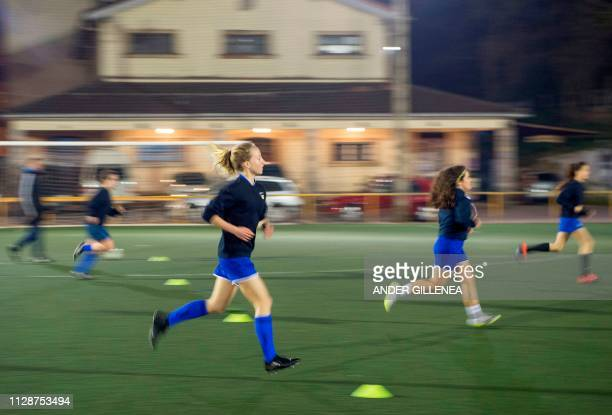 Girls of Anorga KKE football school take part in a training session in the Spanish Basque city of San Sebastian on February 25 2019