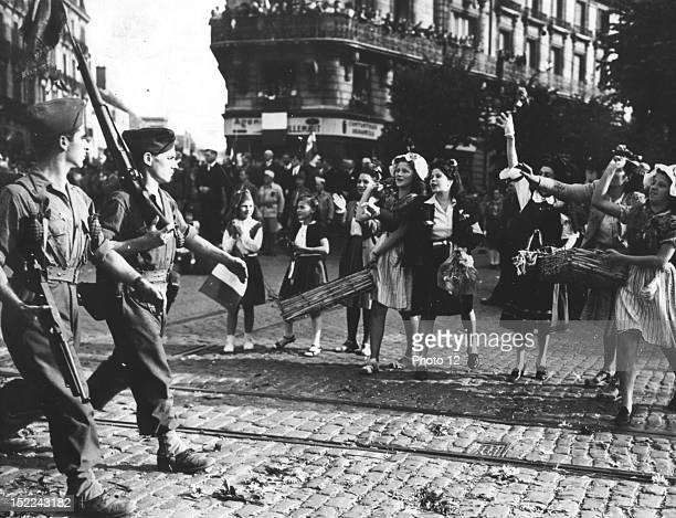 Girls of Dijon greet soldiers of the French Army as they march through the city after wrestling it from German control September 11 1944