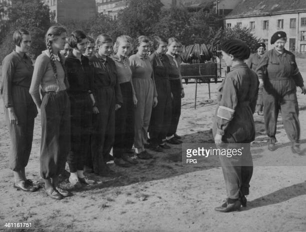 Girls of the Hitler Youth movement undergoing training during World War Two, Germany, circa 1939-1945.
