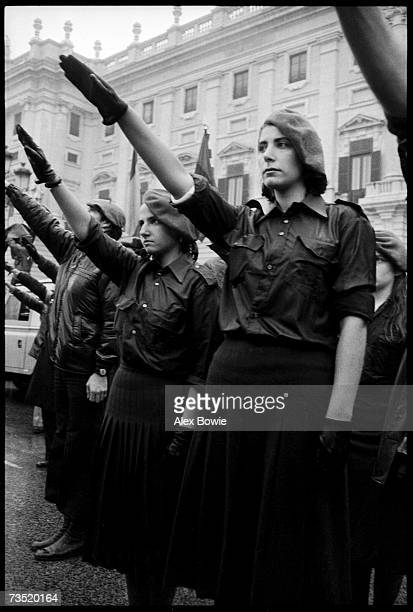 Girls of the neofascist Fuerza Nueva Party at the former Presidential Palace in Madrid give a Nazi salute to commemorate the 2nd anniversary of...
