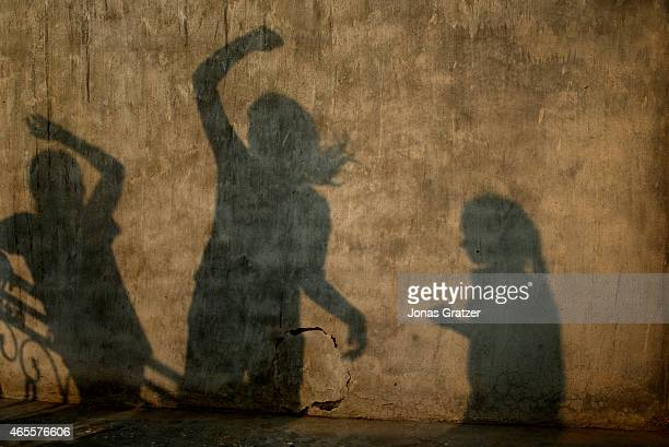 Girls of the Red Brigade wait on the roof of a house to learn self-defense in a suburb called Madiyaon, in the city of Lucknow in India. The Red...