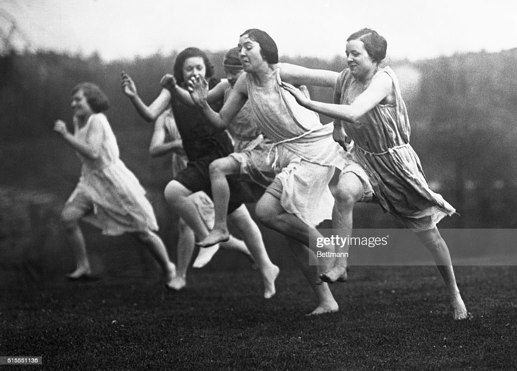 Girls in Grecian Costumes Running 100 Yard Dash : News Photo