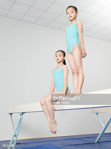 Girls on a balance beam