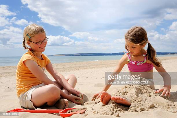 girls on beach - only girls stock pictures, royalty-free photos & images