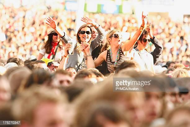 Girls on people's shoulders Crowds V Festival Chelmsford UK 2006