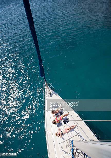 Girls on sailboat deck from top of the mast