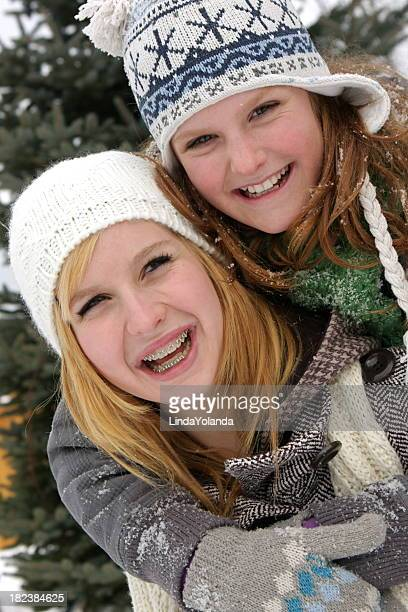 girls outside in the snow - beautiful girl smile braces vertical stock photos and pictures