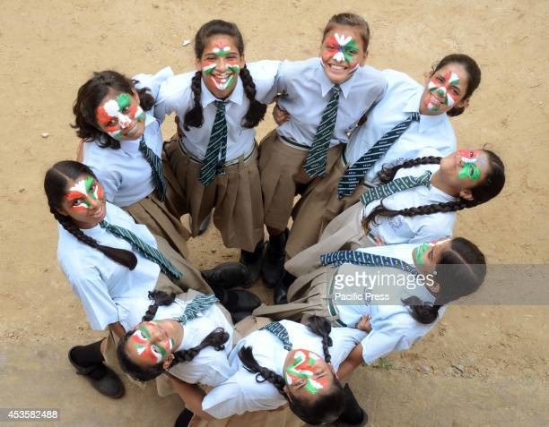 Girls paint their faces with tricolor ahead of Independence Day celebration in Allahabad on Wednesday Observed annually every 15th of August...