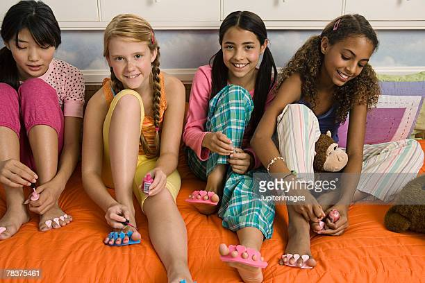 girls painting toenails - black pedicure stockfoto's en -beelden