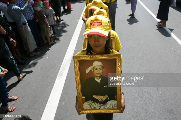 TOPSHOT Girls parade with a portrait of General Aung San during the Martyrs' Day ceremony in Yangon on July 19 2019 Myanmar observes the 72nd...