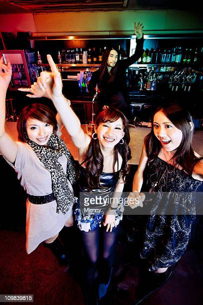 girls partying in nightclub at the bar - playing footsie stock pictures, royalty-free photos & images