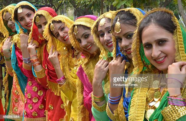 Girls perform 'Giddha' during the fourday interdepartmental cultural event Jashan 2015 at Guru Nanak Dev University onMarch 15 2015 in Amritsar India...