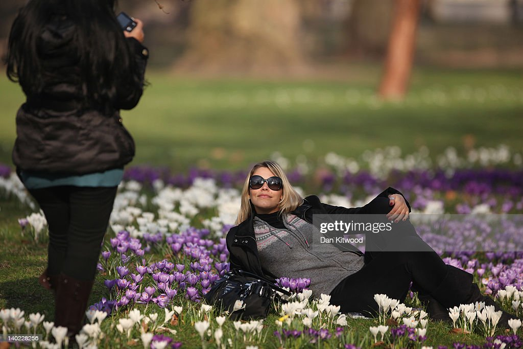 Girls photograph themselves amongst the flowers in St James's Park on March 1, 2012 in London, England. After a recent cold snap Britain is expected to see a short period of unseasonably mild weather following one of the driest February's on record according to the Met Office.