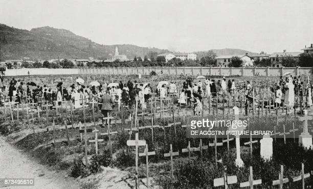 Girls placing flowers on the graves of those fallen in Cormons on the second anniversary of the war Italy World War I from L'Illustrazione Italiana...