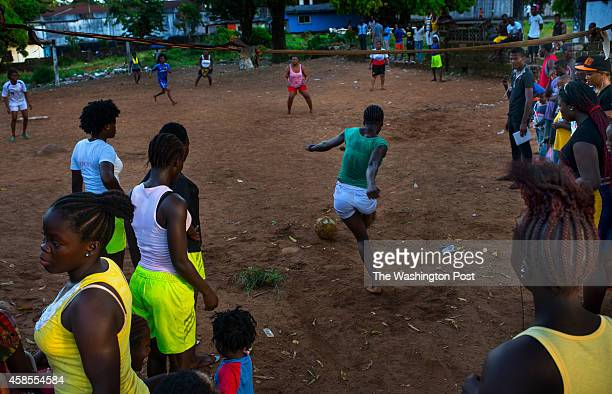 Girls play a kickball match on a soccer field in the Capitol Hill area on Tuesday November 4 2014 in Monrovia Liberia People are more relaxed as...