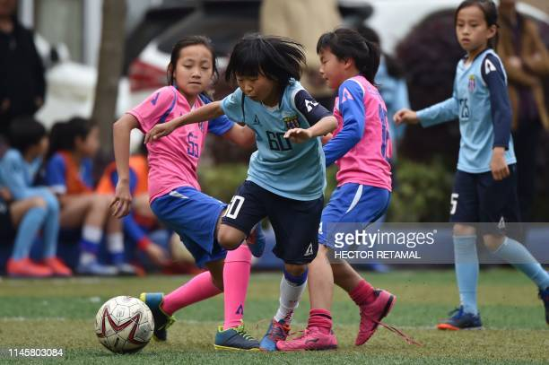 TOPSHOT Girls play football during a training in their school in Shanghai on April 30 2019 China qualified for next month's Women's World Cup for a...