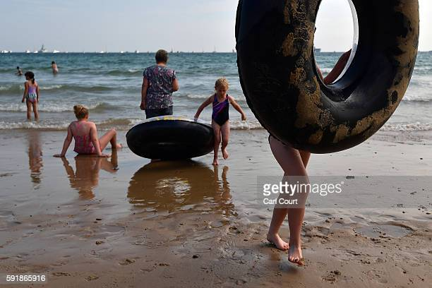 Girls play on the beach with rubber innertubes during the Bournemouth Air Festival on August 18 2016 in Bournemouth England The air show runs from...