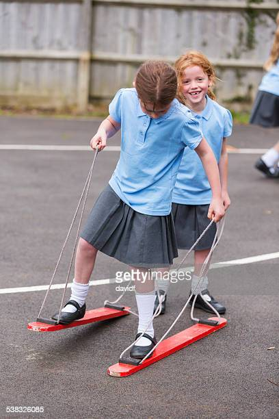 Girls Playing A Balance Game in the School Yard