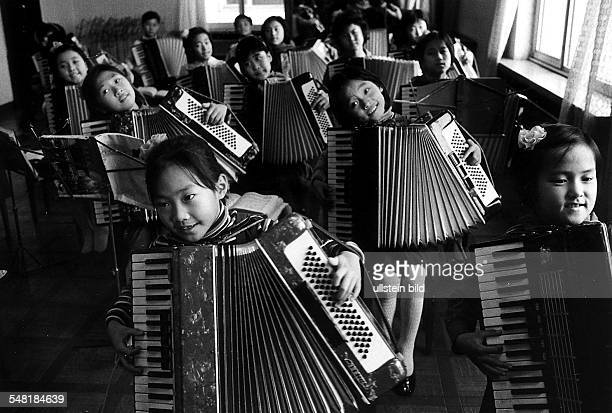 Girls playing accordion in the Pioneers' Palace in Pyongyang