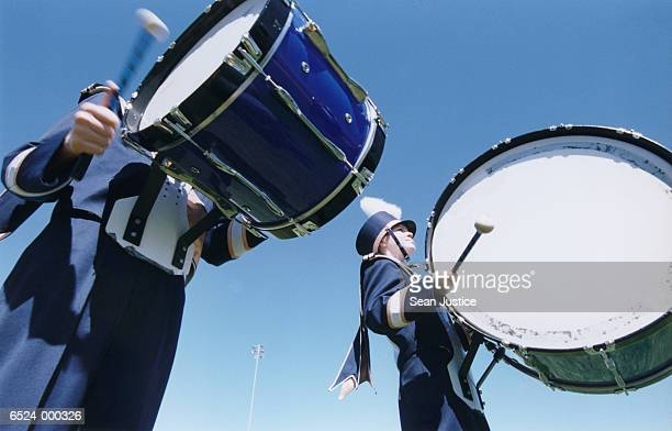 girls playing bass drums - marching band stock pictures, royalty-free photos & images