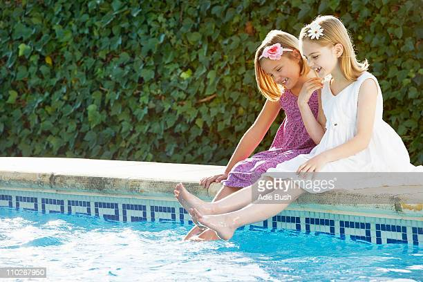 Girls playing by the pool