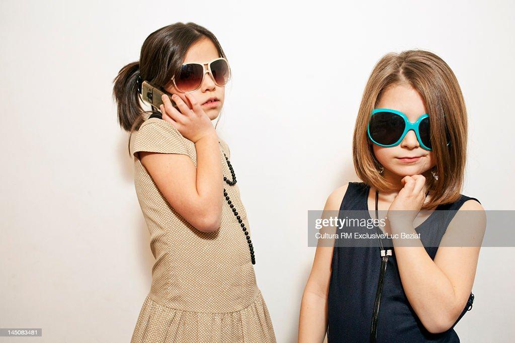 Girls playing dress-up with sunglasses : Bildbanksbilder
