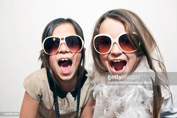 Girls playing dress-up with sunglasses