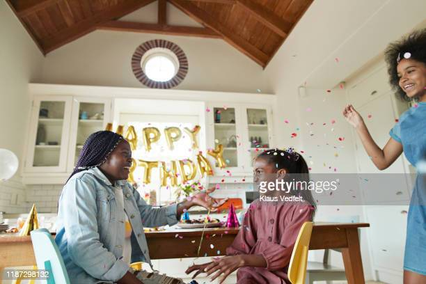 girls playing during birthday party at home - happy birthday images for sister stock pictures, royalty-free photos & images