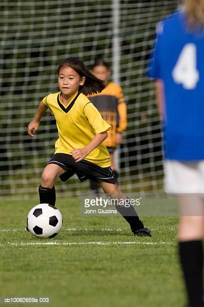 Girls (8-9) playing football