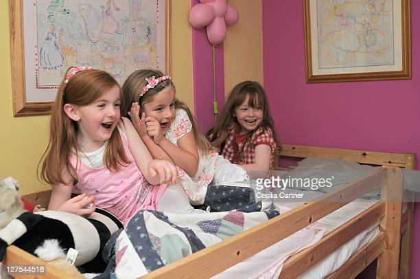 Girls playing in bedroom