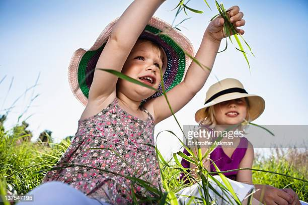 Girls playing in grass together