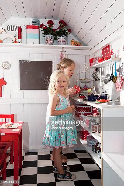 Girls playing in playhouse