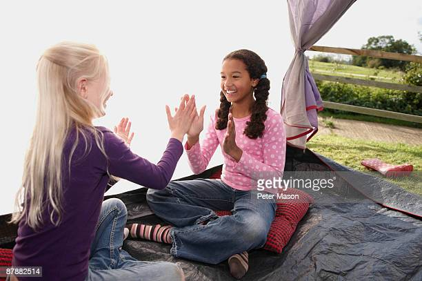 Girls playing in tent