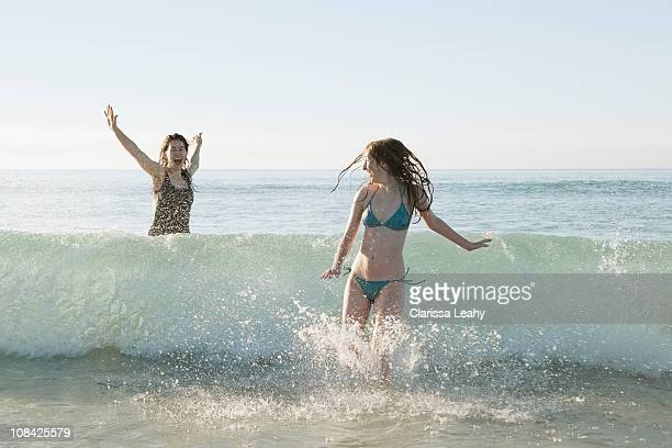 Girls playing in waves