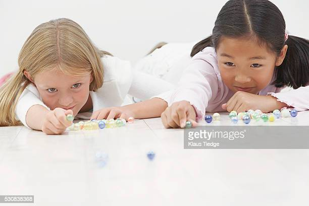 Girls playing marbles