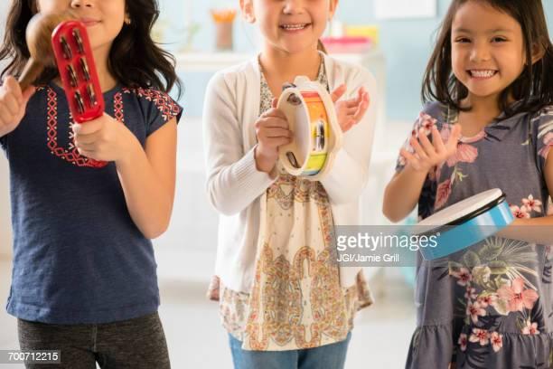 Girls playing music in school