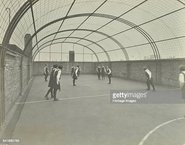 Girls playing netball on a roof playground, Barrett Street Trade School, London, 1927. Artist: unknown.