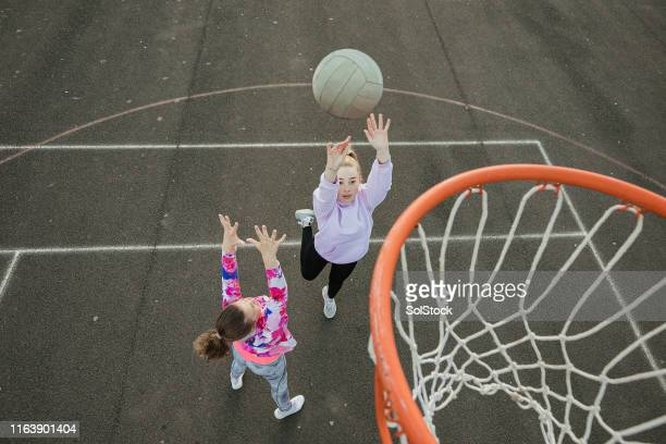 girls playing netball - sporting term stock pictures, royalty-free photos & images