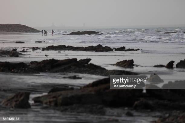 Girls playing on beach in Oman