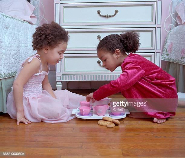 Girls Playing on Bedroom Floor