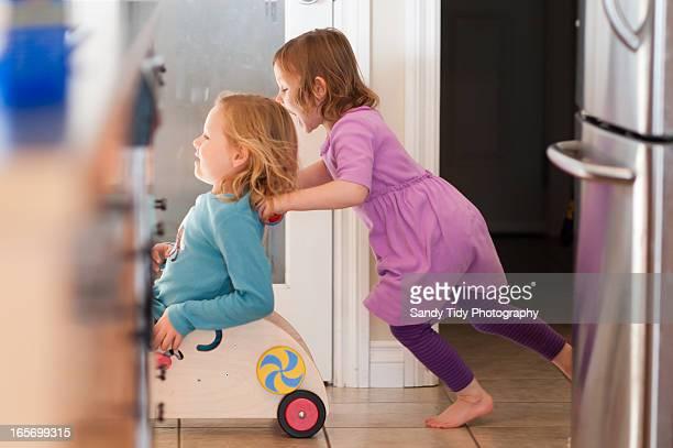girls playing - のりものに乗る ストックフォトと画像